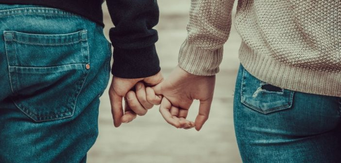 couple holding hands - showing empathy and love