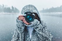 woman in snowy landscape pointing camera toward viewer - concept of free spirit jobs
