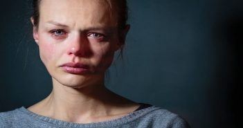 woman with sad, tearful face