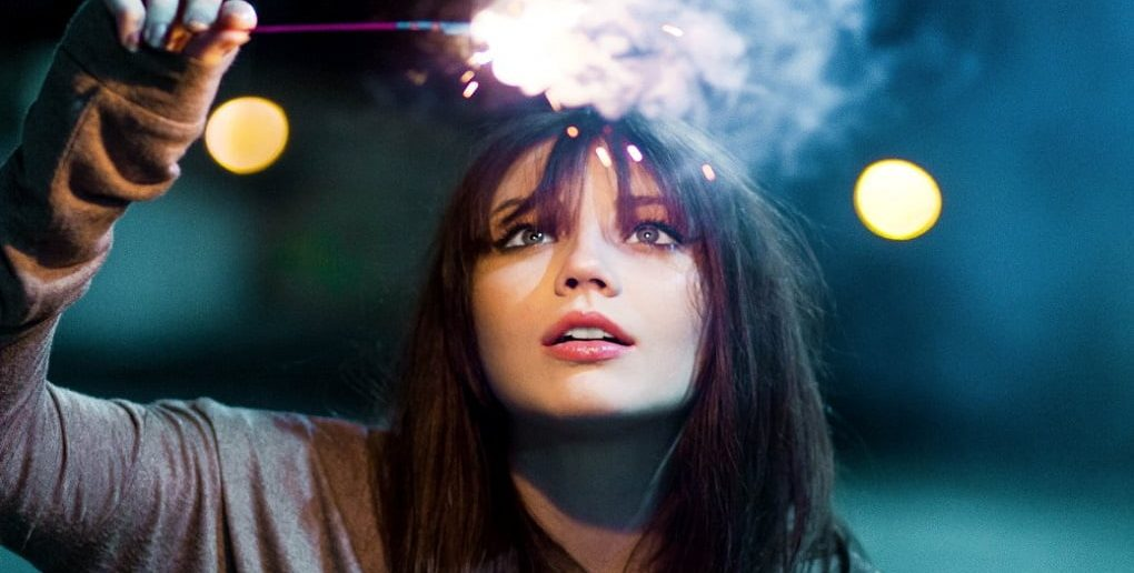 young woman with sparkler - signifying an open mind and wonder
