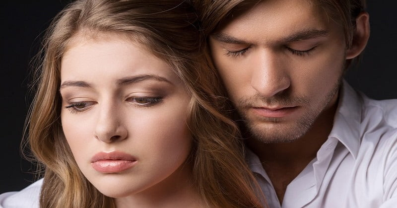 couple with concerned faces - signifying overthinking