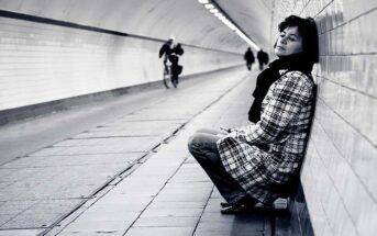 woman in subway walkway feeling like she doesn't belong