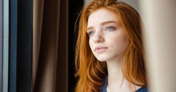 pensive looking young woman thinking about the mistakes she's made