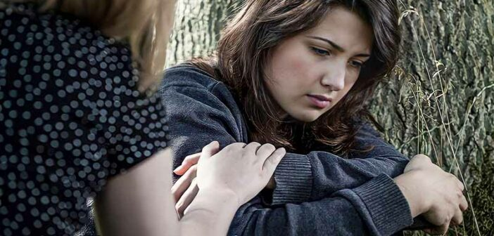 woman being comforted by a friend