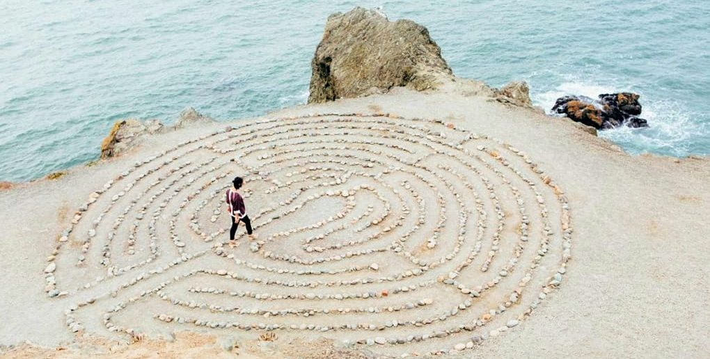 woman in pebble maze