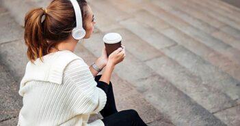 loner woman sitting on steps drinking coffee
