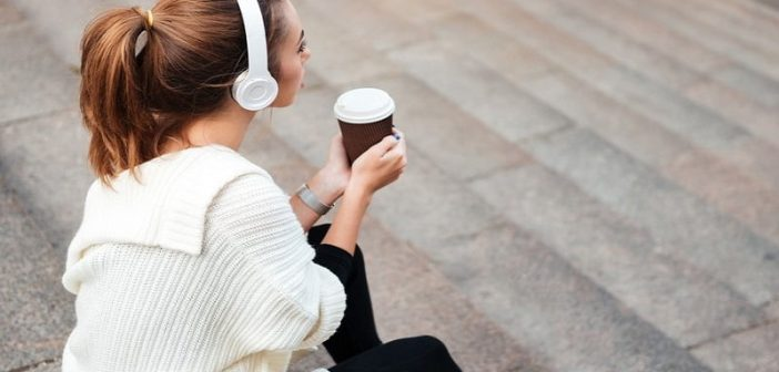 loner woman sitting on steps drinking coffee