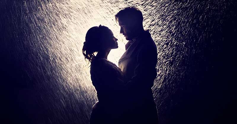 silhouette of couple in the rain signifying unrealistic expectations in a relationship