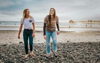 two young women walking up a beach - concept of accepting others
