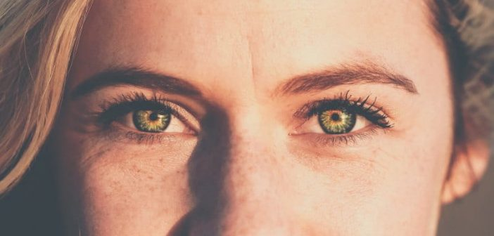 closeup of young woman with green eyes - signifying an Alpha empath