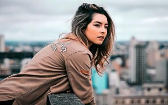 young woman on rooftop looking out over city skyline