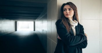 young woman looking pensive