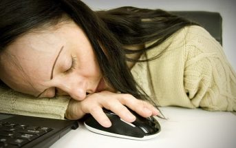 woman asleep at her computer - tired at work