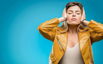 woman covering her ears to signify avoiding the drama of others