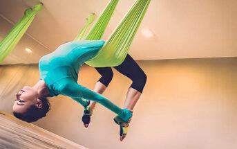 woman balancing in harness indicating a balanced life