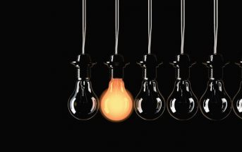 single lit light bulb among dark ones - signifying thinking for oneself