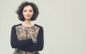 confident looking woman with arms crossed to show she is standing up for herself
