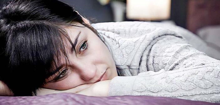 young woman feeling bored with life