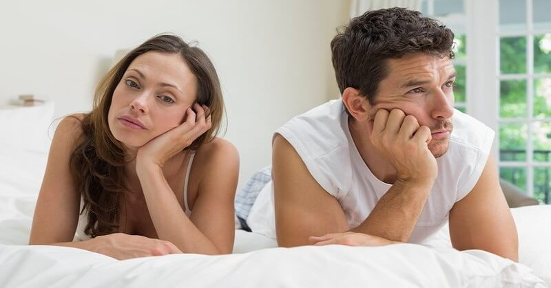 couple looking bored in a relationship with no intimacy