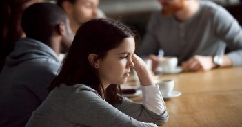 young girl being shunned from group conversation - no one is listening to her