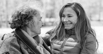 young woman showing respect to older woman