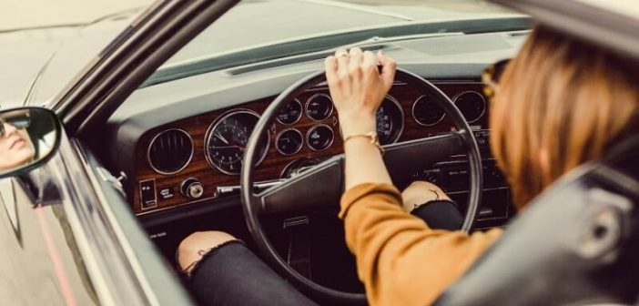 woman behind steering wheel illustrating taking responsibility for your life