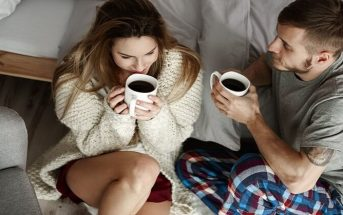 young couple drinking coffee on a couch illustrating loyalty in relationships