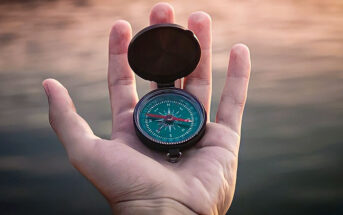 hand holding moral compass illustrating a life lived with integrity