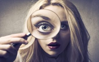 woman looking through spyglass illustrating finding your talent