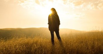 silhouette of woman against sunrise illustrating living life to the fullest