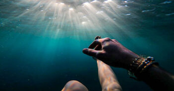 a person beneath the waves illustrating self-destructive behavior