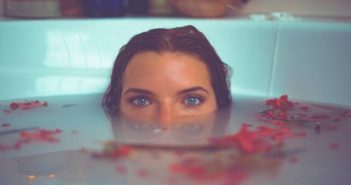 young empath woman submerged in bath