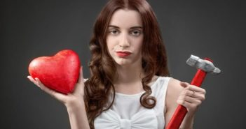 woman holding heart and hammer illustrating her relationship deal breakers