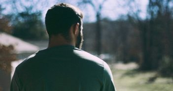 man looking into distance illustrating pulling away from a partner