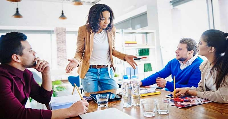 woman in business meeting not explaining things well