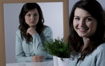 smiling girl with unhappy mirror reflection illustrating lying to yourself