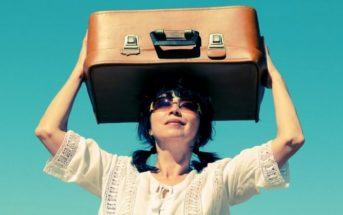 middle-aged woman holding suitcase above her heard illustrating leaving everything behind to start a new life