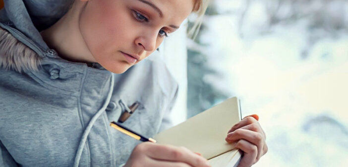 young woman journaling