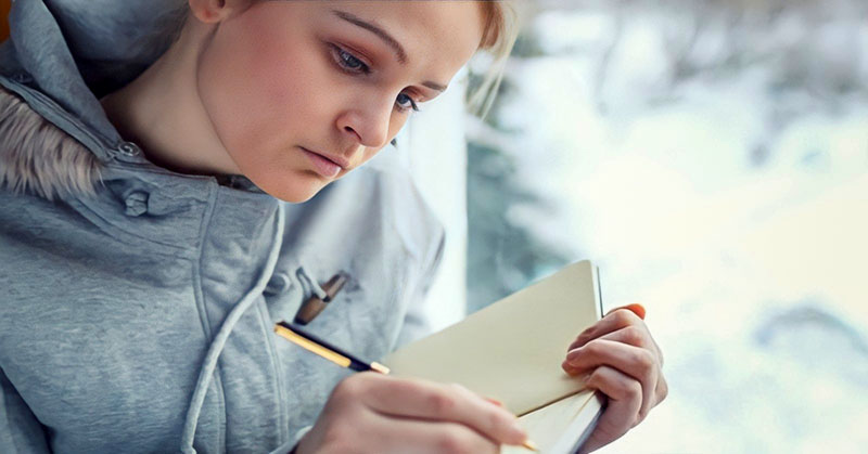 young woman journaling