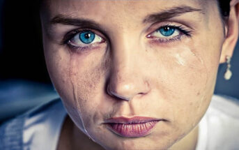 closeup of crying woman with tears running down her face