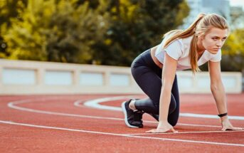 female runner under starters orders illustrating motivation
