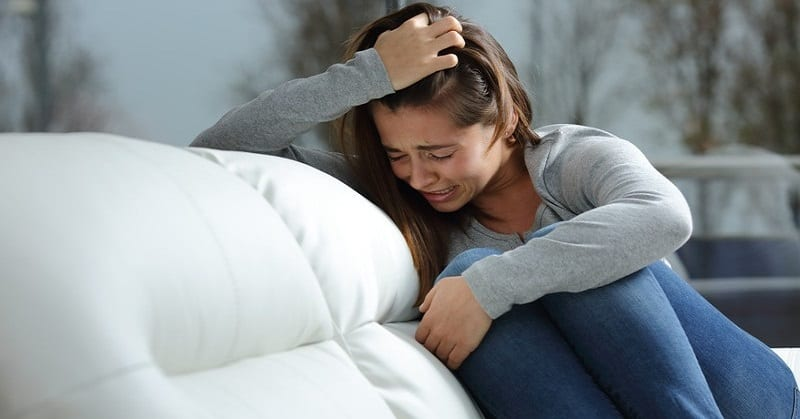 young woman experiencing great emotional pain after a breakup