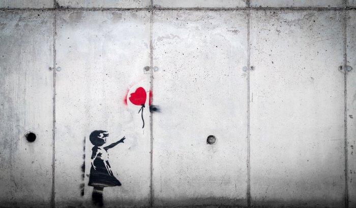 graffiti artwork of girl losing heart balloon
