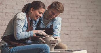 man and woman doing pottery together illustrating hobbies for couples