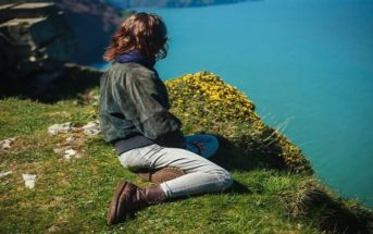 woman on clifftop thinking about her priorities in life