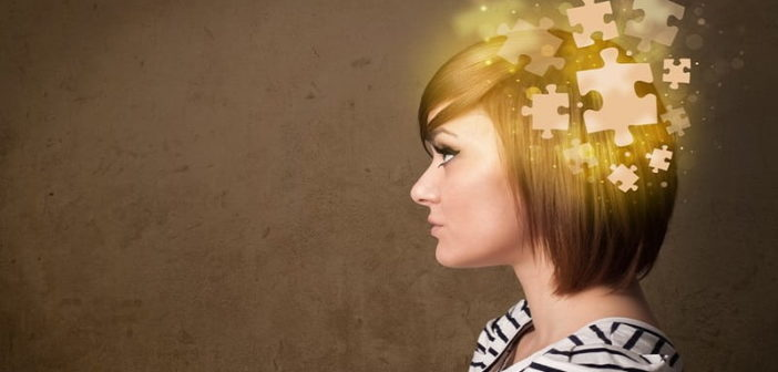 woman with jigsaw puzzle superimposed on head illustrating self-esteem and self-confidence