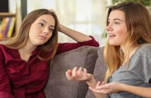 woman talking about herself non-stop while friend looks bored - illustrating the concept of conversational narcissism