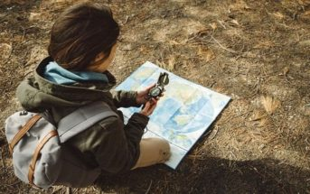 woman with map and compass illustrating the idea of trusting yourself
