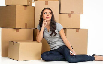 woman sitting in front of lots of boxes - illustrating the concept of compartmentalizing emotions