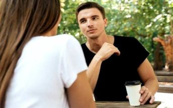 bored man on a date showing that he's not into you
